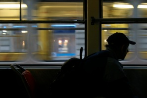 On the number 9 tram in Prague, Czech Republic, 5 am starts to bring people to work. This man consoles his dog and stares out the window as another tram passes. 2007