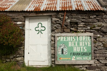On the Dingle Peninsula, in County Kerry, Ireland, a beehive hut or clochán tourism stop. The Fahan clocháns are believed to date back to the 12th century. 2013