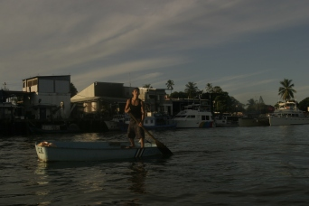 "A local yells ""Pura Vida"" as we pass him in our boat. Puntarenas, Costa Rica. 2009"