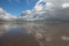 The sky was mirrored on the slick Inch Beach.
